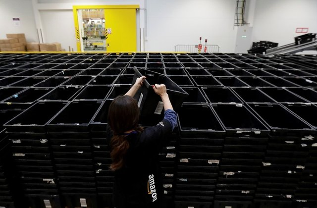an employee works at the amazon fulfillment center in the village of dobroviz near prague czech republic december 20 2018 photo reuters