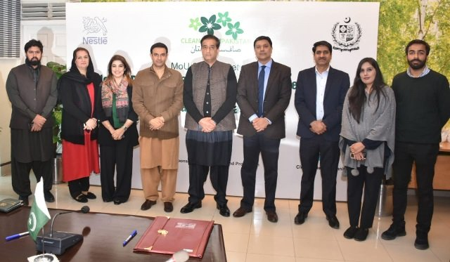 waqar ahmed head of corporate affairs nestle pakistan malik amin aslam adviser to the prime minister on climate change and other officials after signing an mou for the 039 clean green pakistan movement 039 photo express