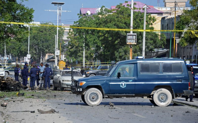 somali security forces gather at the site of a bomb blast near makka al mukarama road in the somali capital mogadishu on december 19 2015 photo afp