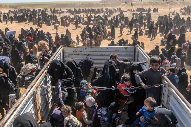 civilians evacuated from the islamic state is group 039 s embattled holdout of baghouz wait at a screening area held by the us backed kurdish led syrian democratic forces sdf in the eastern syrian province of deir ezzor on march 6 2019 photo afp