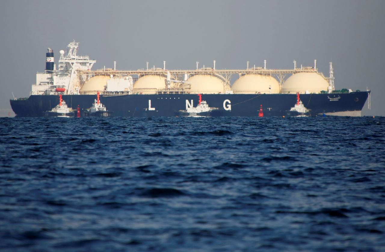 a liquefied natural gas lng tanker is tugged towards a thermal power station photo file