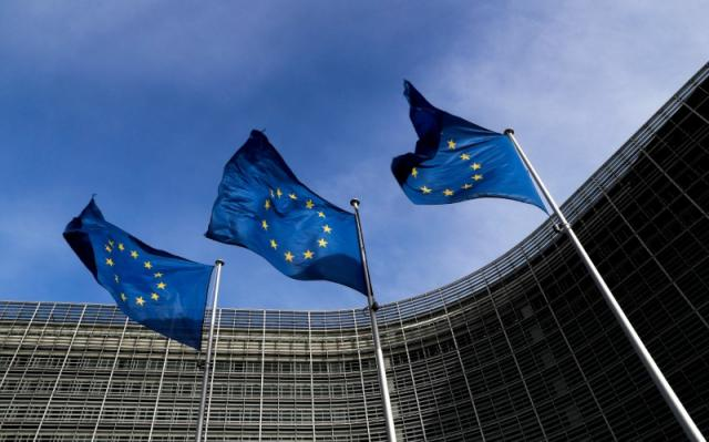 european union flags flutter outside the eu commission headquarters in brussels photo reuters