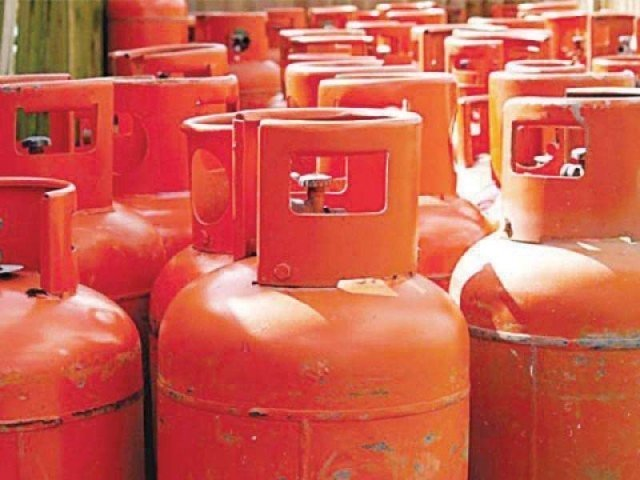 focus on manufacturing lpg cylinders and car batteries photo file