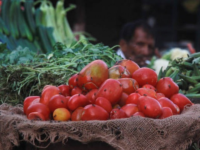 trucks loaded with indian tomatoes and garlic have begun to reach the vegetable markets in rawalpindi and lahore photo file