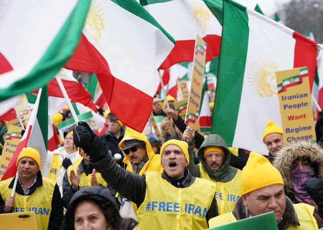 protesters in washington waved iranian flags as they chanted for quot regime change now quot photo afp