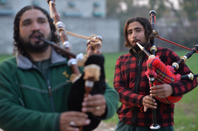 a pakistani musical band performs with bagpipes photo afp