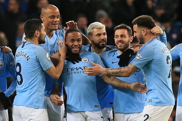 manchester city 039 s english midfielder raheem sterling c celebrates scoring his first goal with teammates during the english premier league football match between manchester city and watford at the etihad stadium in manchester photo afp