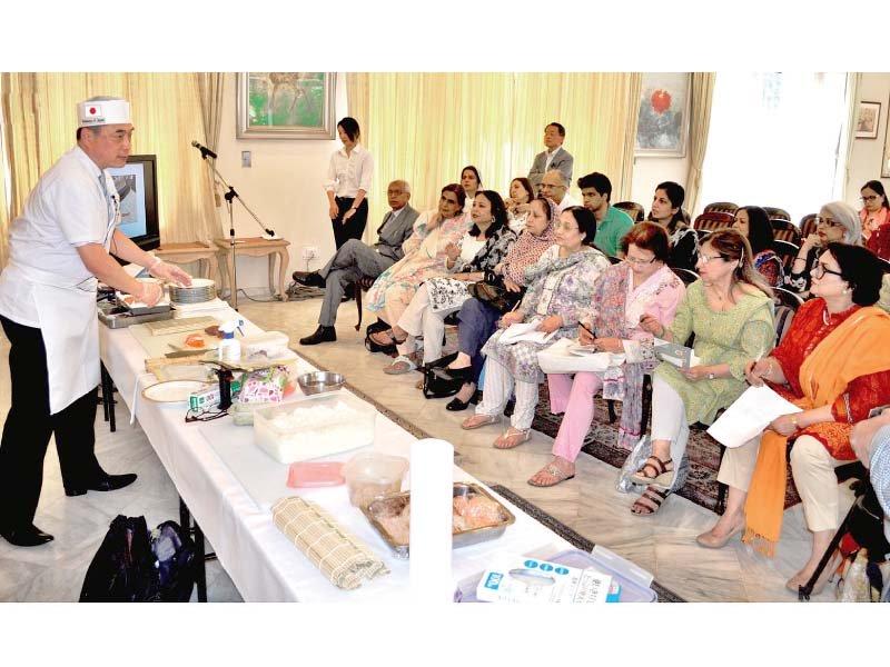 japan deputy consul general exhibits his sushi making skills