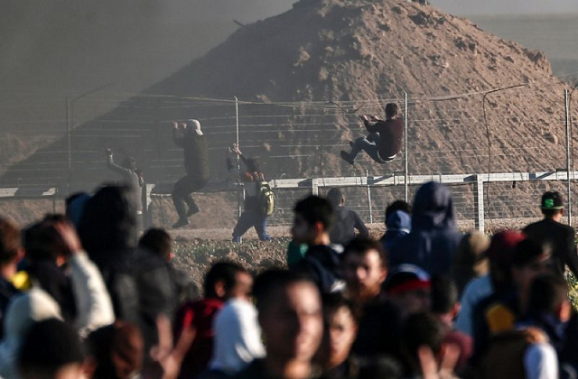 For nearly a year Palestinian protesters have been gathering along the Gaza-Israel border calling for Palestinian refugees and their descendants to be allowed to return to former homes now inside Israel. PHOTO: AFP