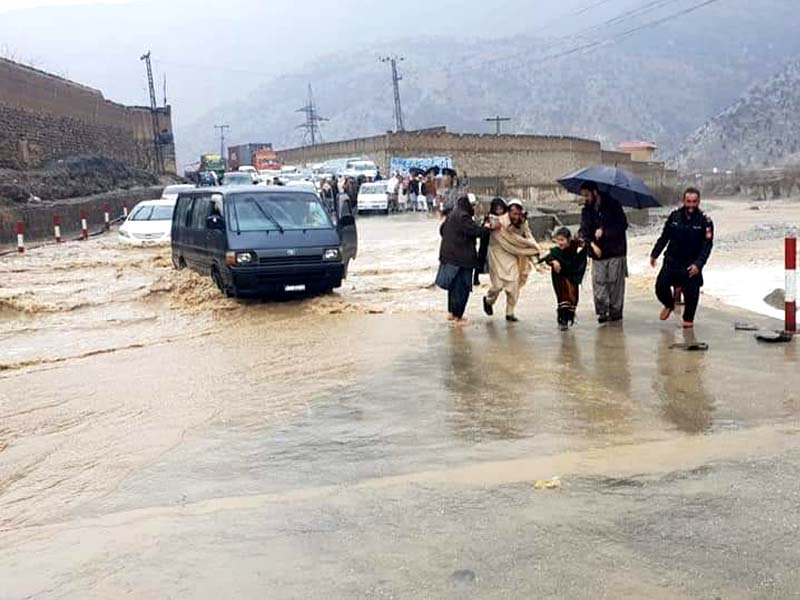 a snow woman in parachinar and view of peshawar kohat road after heavy rain photos express