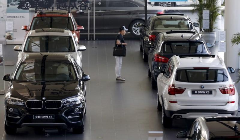 a man checks out luxury vehicles at a showroom photo reuters