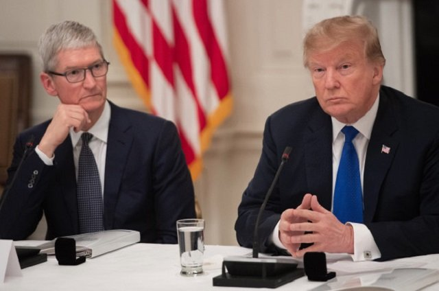 apple ceo tim cook l listens to us president donald trump during an american technology council roundtable at the white house in washington dc on june 19 2017 photo afp