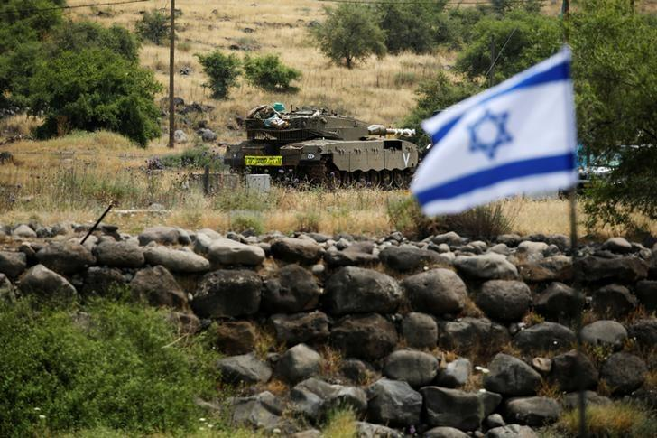 An Israeli tank can be seen near the Israeli side of the border with Syria in the Israeli-occupied Golan Heights.PHOTO REUTERS