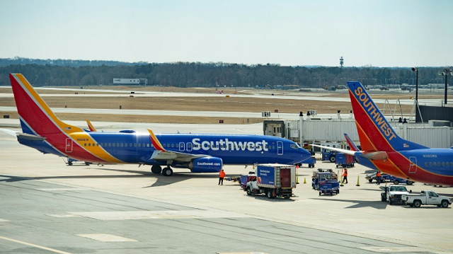 a boeing 737 max 8 flown by southwest airlines taxis to the gate at baltimore washington international airport near baltimore maryland on march 13 2019 photo afp