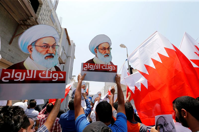 protesters holding bahraini flags and placards with images of bahrain 039 s leading shi 039 ite cleric isa qassim shout religious slogans during an anti government protest after friday prayers in the village of diraz west of manama bahrain august 12 2016 photo reuters
