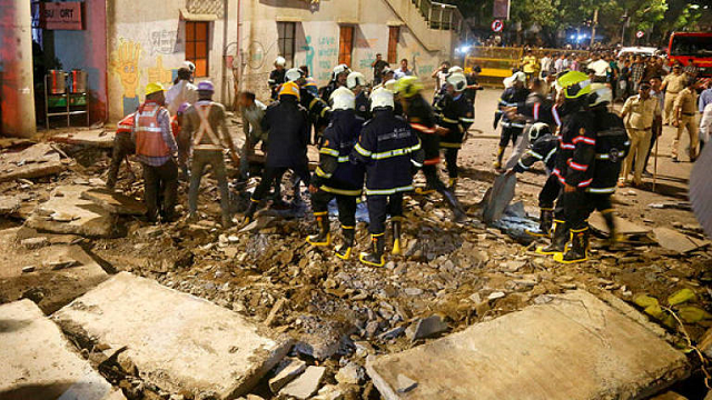 rescue workers and fire brigade personnel remove debris at the site of a footbridge after its collapse outside the chhatrapati shivaji maharaj terminus railway complex in mumbai photo afp