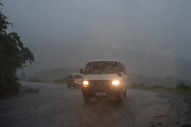 picture shows vehicules as rain which is believed to be the beginning of tropical cyclone idai coming from central mozambique