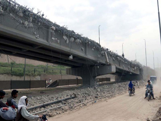 file photo of malik saad shaheed flyover being razed to pave way for the brt project photo express
