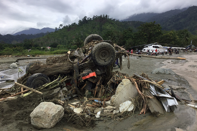 at least 50 killed by flash floods in indonesia s papua