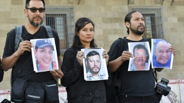 journalists hold up photos of slain colleagues at a rally in mexico city in june 2018 photo afp