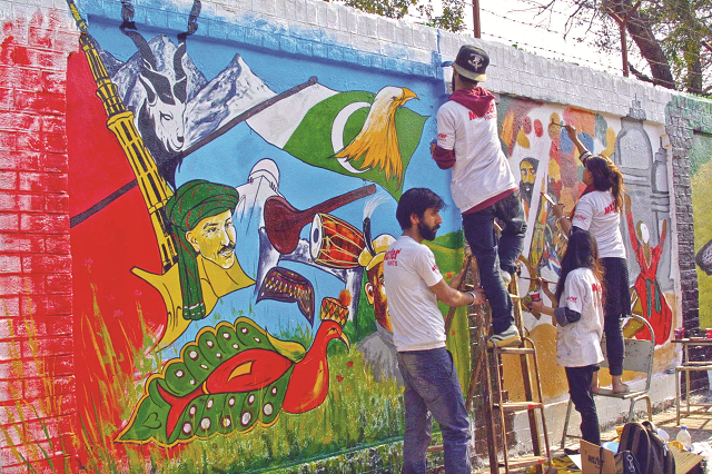 students paint a mural at wahdat road in lahore photo ppi