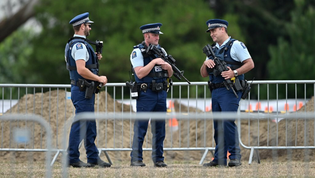 armed police officers patrol gravesites for victims in christchurch on march 18 2019 three days after a shooting incident killed at least fifty people in mosques in the city photo afp