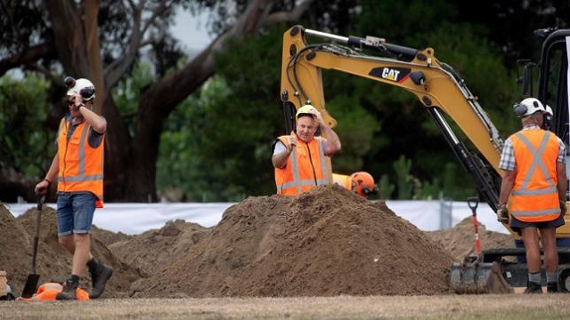 workers dig grave sites at a cemetery in christchurch on march 17 2019 two days after a shooting incident at two mosques in the city photo afp