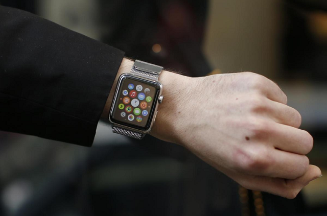a customer presents his apple watch after buying it at a store in paris france april 24 2015 photo reuters