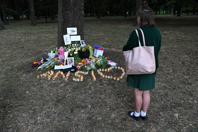 a student pays respect at a memorial site for the victims of mosque attacks in christchurch photo afp