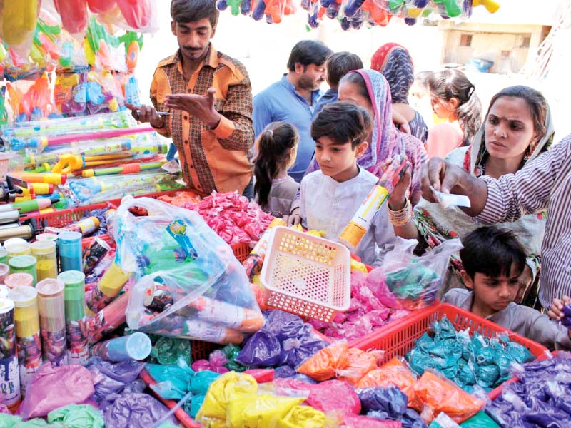 members of the hindu community buy colours at swami narain mandir as part of preparations for holi to be celebrated today photo online