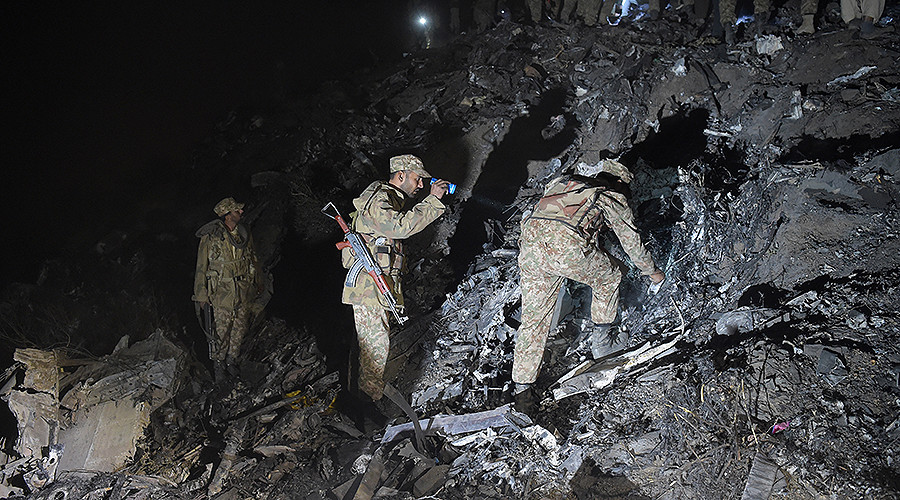 soldiers search for victims from the wreckage of the crashed pia passenger plane flight pk661 at the site near abbottabad on december 7 2016 photo afp file