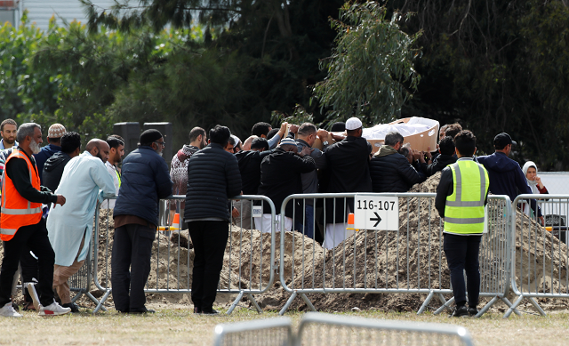 The body of a victim of the mosque attacks is carried during the burial ceremony at the Memorial Park Cemetery in Christchurch. PHOTO: REUTERS