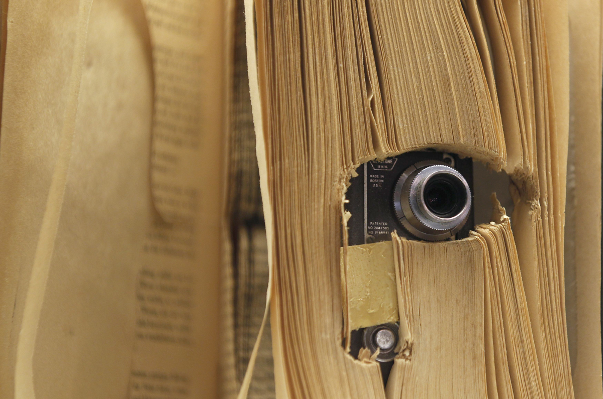 a small photo camera placed in a book and used by the u s central intelligence agency cia is displayed at the 039 top secret 039 spy museum in oberhausen july 10 2013 photo reuters