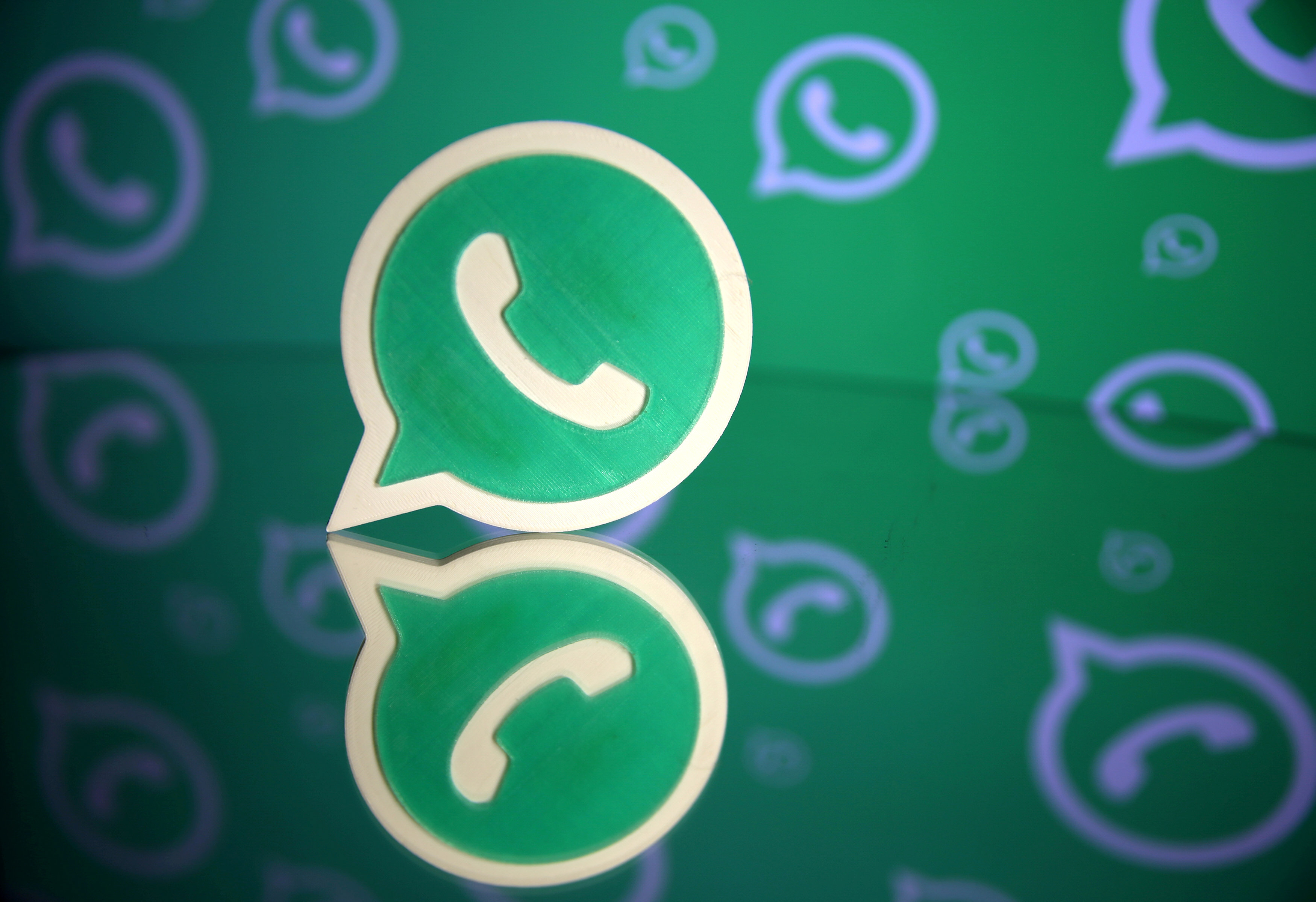 a 3d printed whatsapp logo is seen in front of a displayed whatsapp logo in this illustration september 14 2017 photo reuters