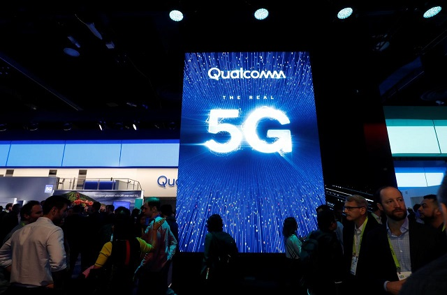 people walk by a video display promoting 5g connectivity at the qualcomm booth during the 2019 ces in las vegas nevada us january 8 2019 photo reuters