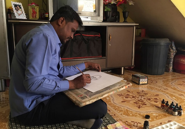 ganesh bhalerao a cartoonist hired by the ruling bharatiya janata party draws a cartoon inside his home in pune india february 28 2019 photo reuters