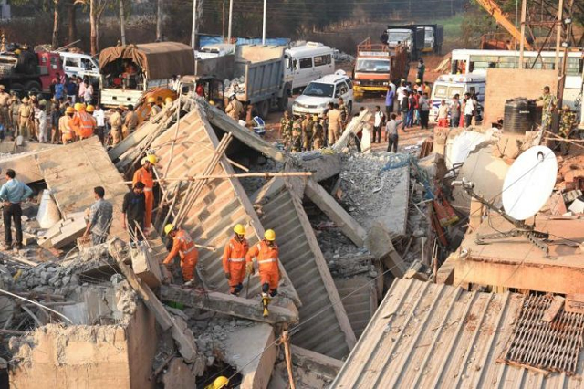 three rescued after three days under collapsed indian building