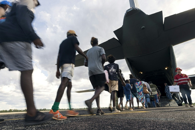 residents of mcarthur river a remote town in the northern territory boarding an australian military plane as authorities evacuate communities in the path of a powerful cyclone photo afp