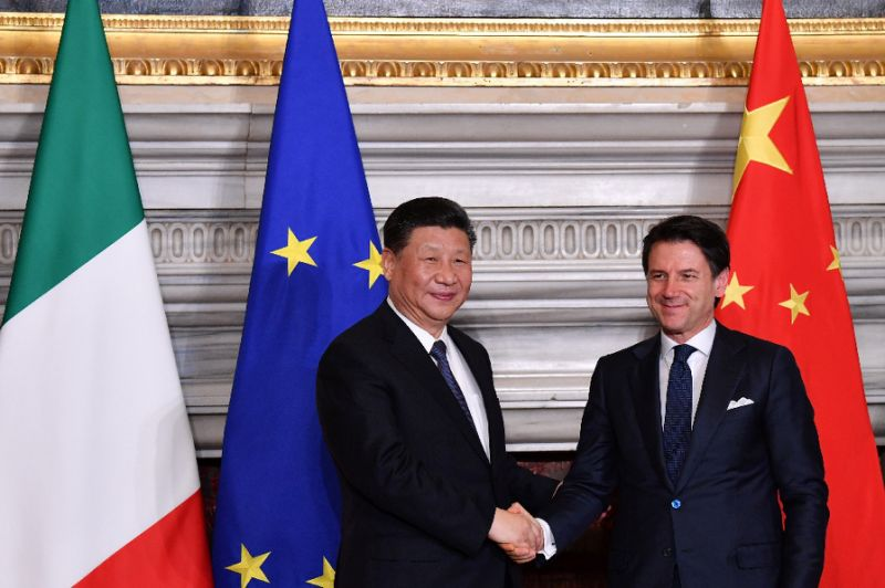 china 039 s president xi jinping and italy s prime minister giuseppe conte shake hands at their signing ceremony of partnership agreements in rome as italy becomes the first g7 country to sign up to beijing 039 s new silk road photo afp