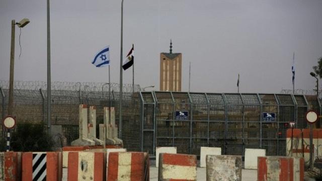 israeli and egyptian flags seen at the nitzana border crossing along their border near the israeli village of nitzanei sinai photo afp