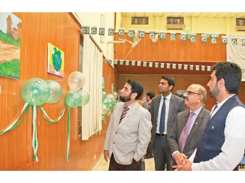 numl dg muhammad ibrahim looks at art works of students photo express