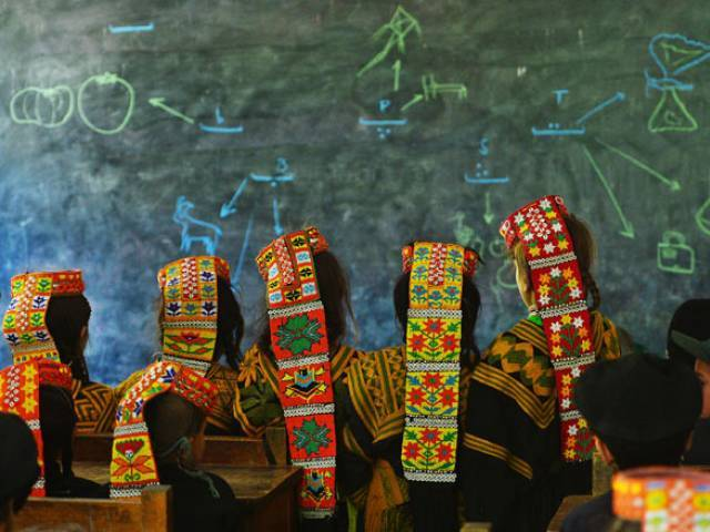 in this photograph taken on october 31 2015 kalash students attend a class at a school in the brun village of bumboret valley photo afp