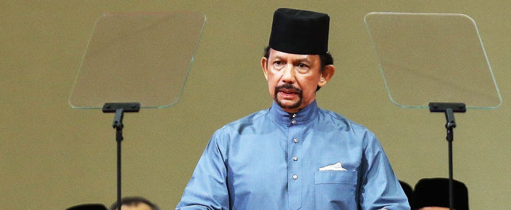 brunei 039 s sultan hassanal bolkiah delivers a speech during the official ceremony of the implementation of sharia law in bandar seri begawan photo afp