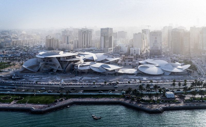 the new national museum of qatar which was designed by french architect jean nouvel features a multi curved roof which resembles a jigsaw puzzle photo afp