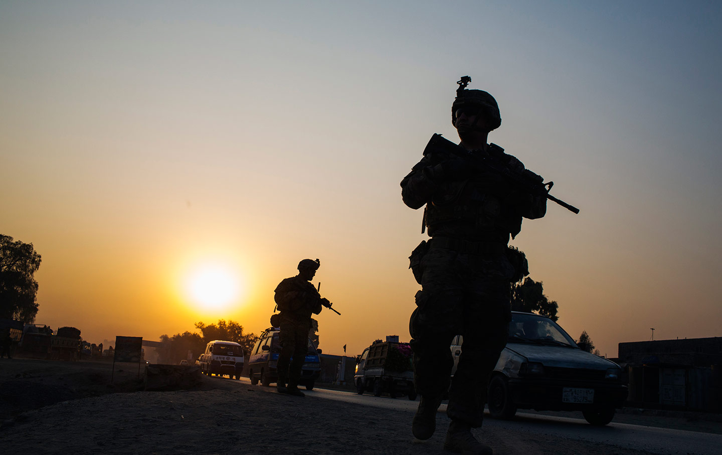 us soldiers walk near a police checkpoint in afghanistan photo reuters