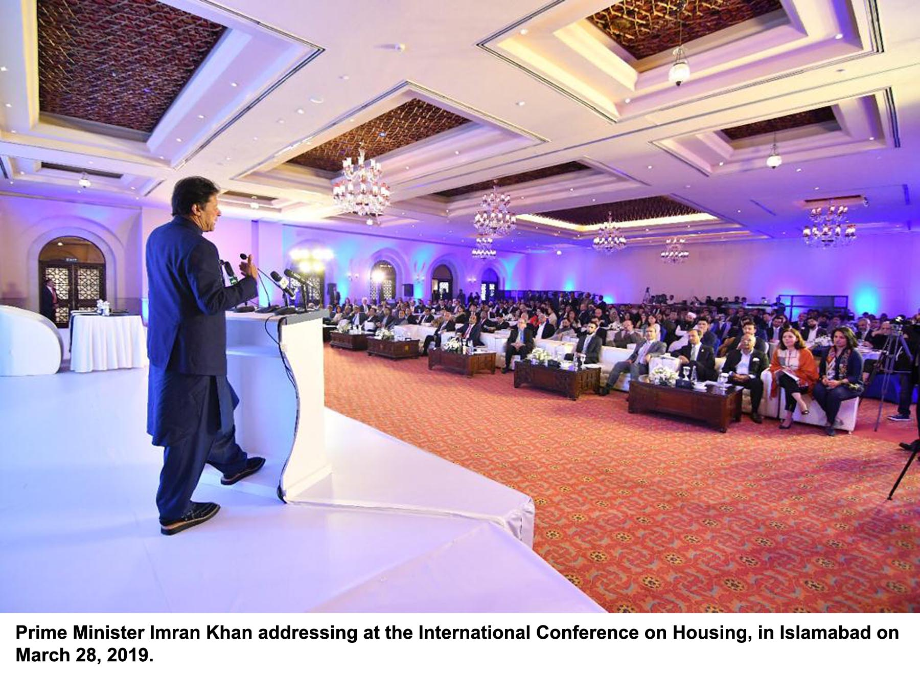 PM Imran Khan addresses the International Housing Conference in Islamabad on Thursday. PHOTO: PID