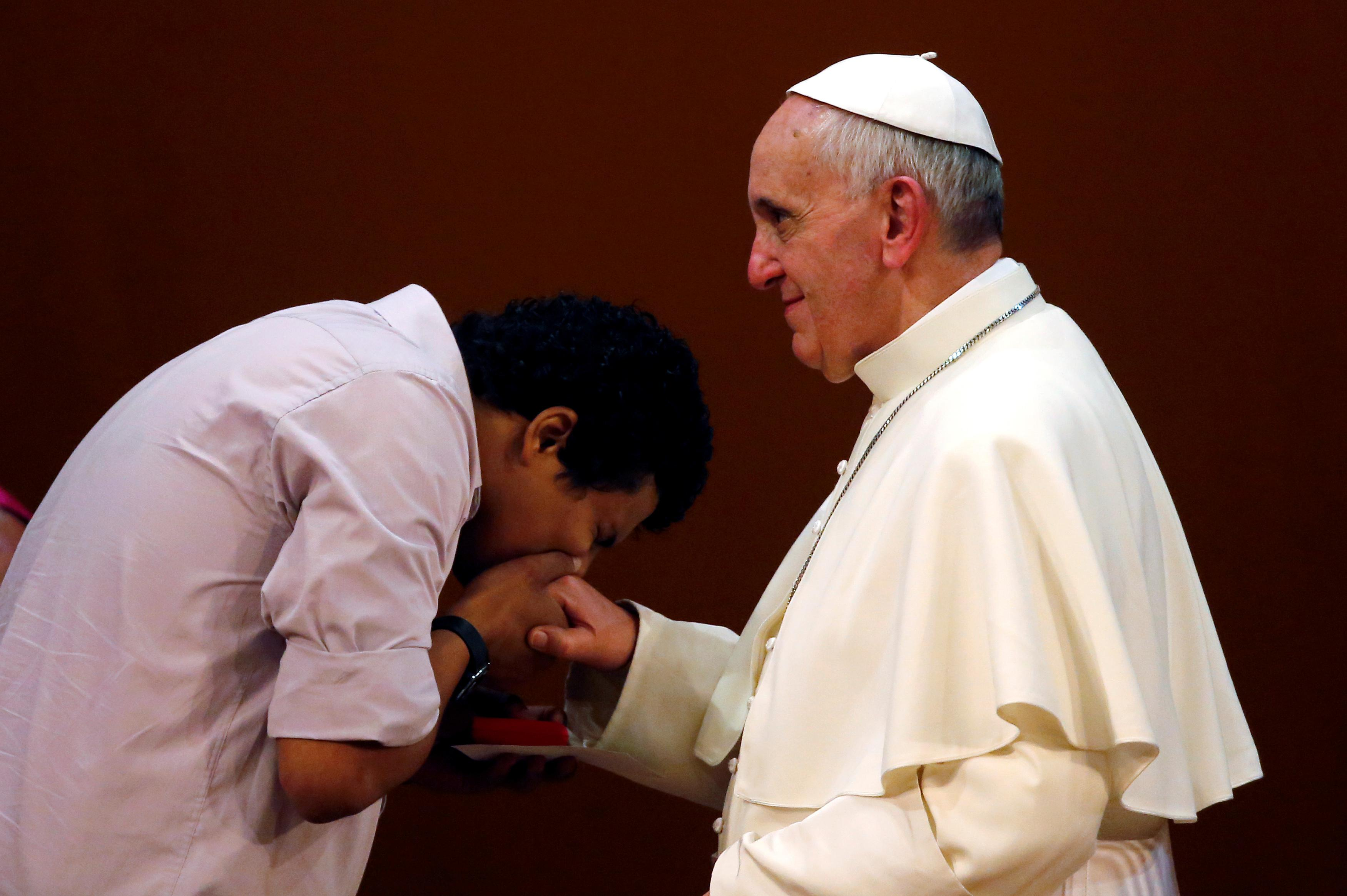 a youth kisses the ring of pope francis during a meeting at the municipal theater in rio de janeiro photo reuters