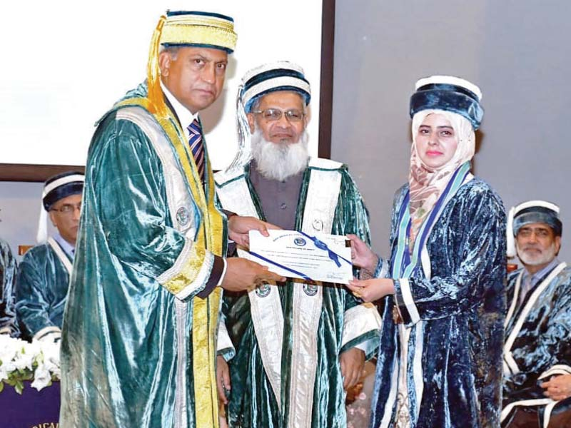 pof board chairman presenting a certificate to dr farhana kausar the best graduate of session 2013 2018 at the 9th convocation of wah medical college photo express