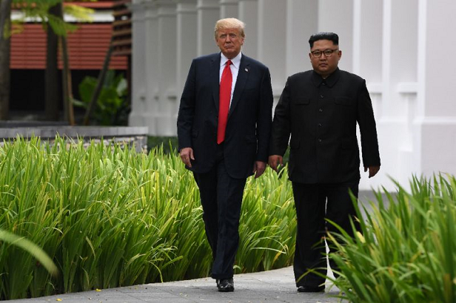 with a piece of paper trump called on kim to hand over nuclear weapons