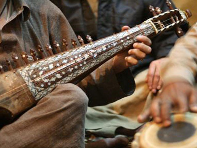 renewed interest in music spurs growth of market on shah allah ditta road photo reuters file